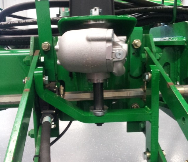 A closeup of the hydraulic down force machine.